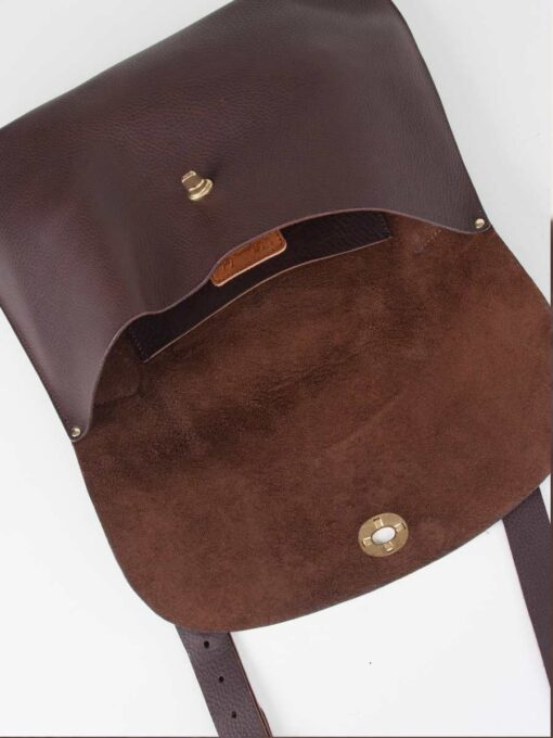 inside a brown leather bag