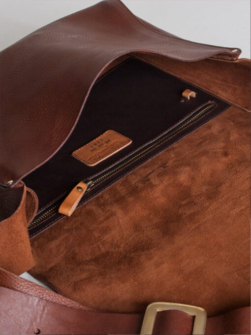 Inside detail of leather messenger bag tan