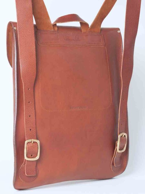 Leather rucksack in tan with a swivel lock
