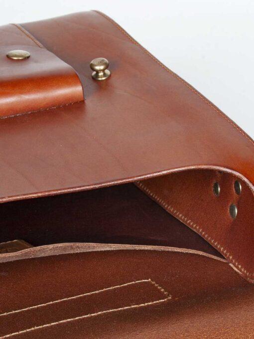 deatil of leather messenger style satchel
