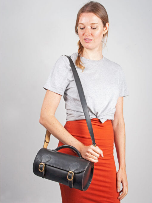 black round leather cross body bag